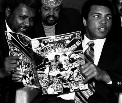 Ali reading Superman vs