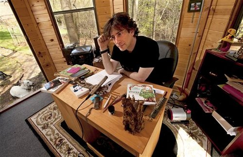 Neil Gaiman at desk