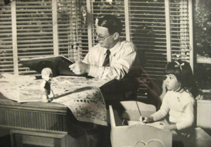 James C Bancks drawing the strip with his little daughter, Sheena