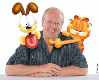 Jim Davis with Odie and Garfield